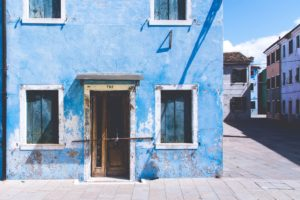 How to handle insurance denial? A blue house with mold on the facade.