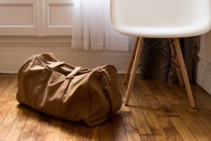 Bag on the floor left for moving out after a breakup