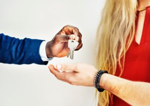 a realtor giving the key to a man