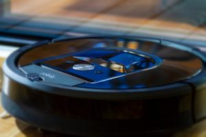 black robot vacuum and cleaner
