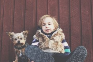 A kid with a dog.
