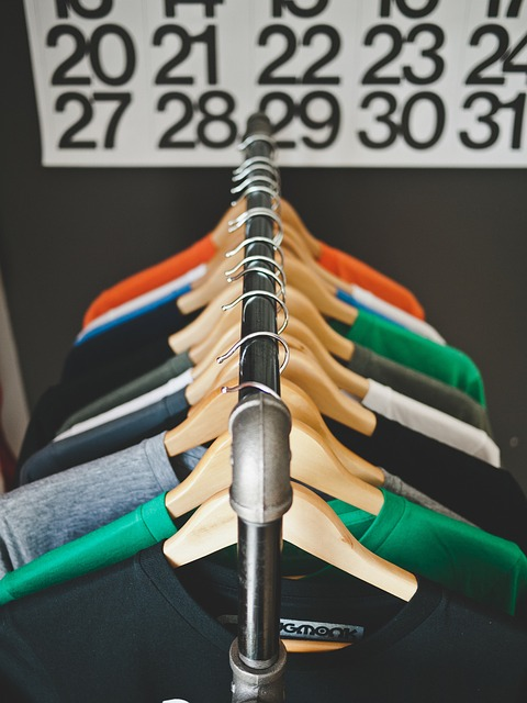 T-shirts neatly arranged on hangers.