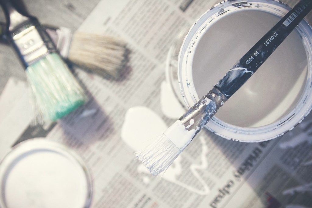 Paint brush and a paint bucket.
