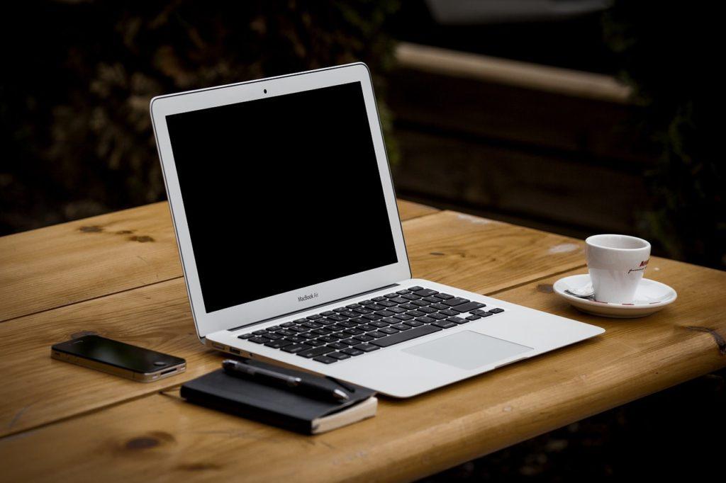A laptop on a desk.