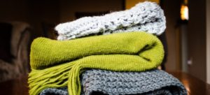 Three different blankets which can be useful for protecting wooden floors when moving.