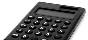 A black calculator to set the costs for buying in Kansas.