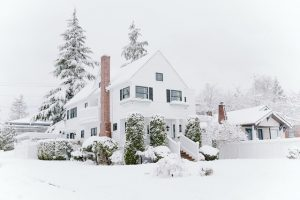 A family house covered in snow but still a good choice for those who are house hunting in the winter.