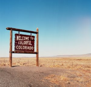 """A sign that says """"Welcome to colorful Colorado"""" that you'll pass by if you relocate from Hong Kong to Colorado."""