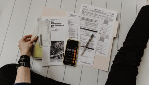 Papers and a calculator for setting up a budget when relocating to Colorado from Hong Kong.