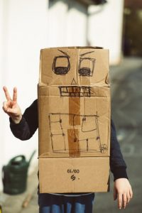 A goofy dude wearing a cardboard box with a drawn face on it, while you all pack your family.