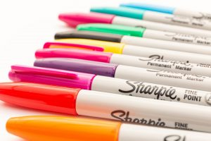 An image of different colored sharpies