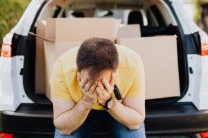 A sad man sitting in a car.